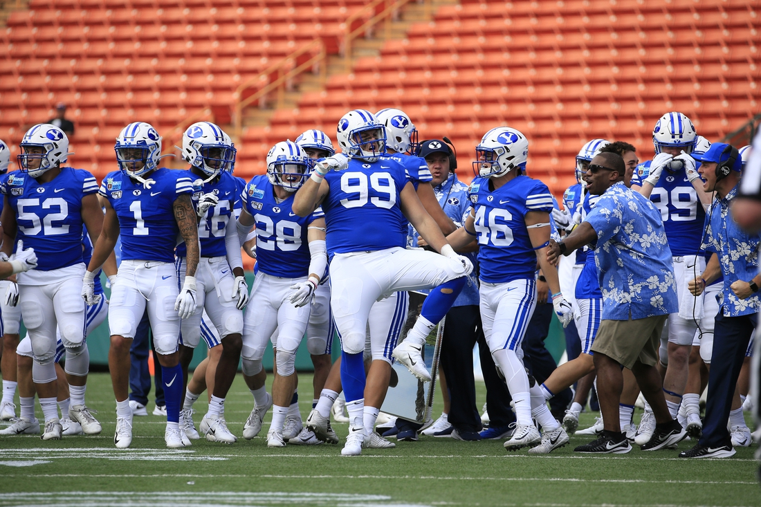 Dec 24, 2019; Honolulu, Hawaii, USA; Brigham Young Cougars defensive lineman Zac Dawe (99) celebrates with teammates after a sack against Hawaii in the first half of the Hawaii Bowl at Aloha Stadium. Mandatory Credit: Marco Garcia-USA TODAY Sports
