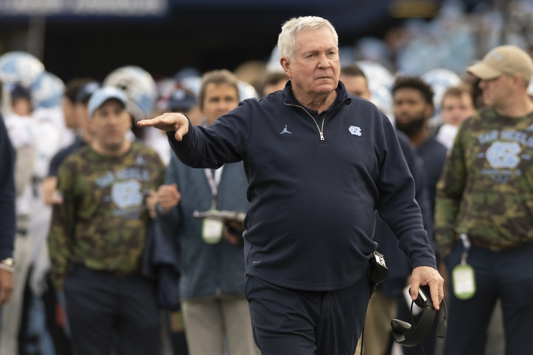 Dec 27, 2019; Annapolis, Maryland, USA;  North Carolina Tar Heels head coach Mack Brown walks down the sidelines during the fourth quarter against the Temple Owls at Navy-Marine Corps Memorial Stadium. Mandatory Credit: Tommy Gilligan-USA TODAY Sports