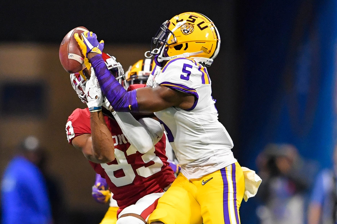 Dec 28, 2019; Atlanta, Georgia, USA; LSU Tigers cornerback Kary Vincent Jr. (5) intercepts a pass intended for Oklahoma Sooners wide receiver Nick Basquine (83) during the second quarter of the 2019 Peach Bowl college football playoff semifinal game at Mercedes-Benz Stadium. Mandatory Credit: Dale Zanine-USA TODAY Sports