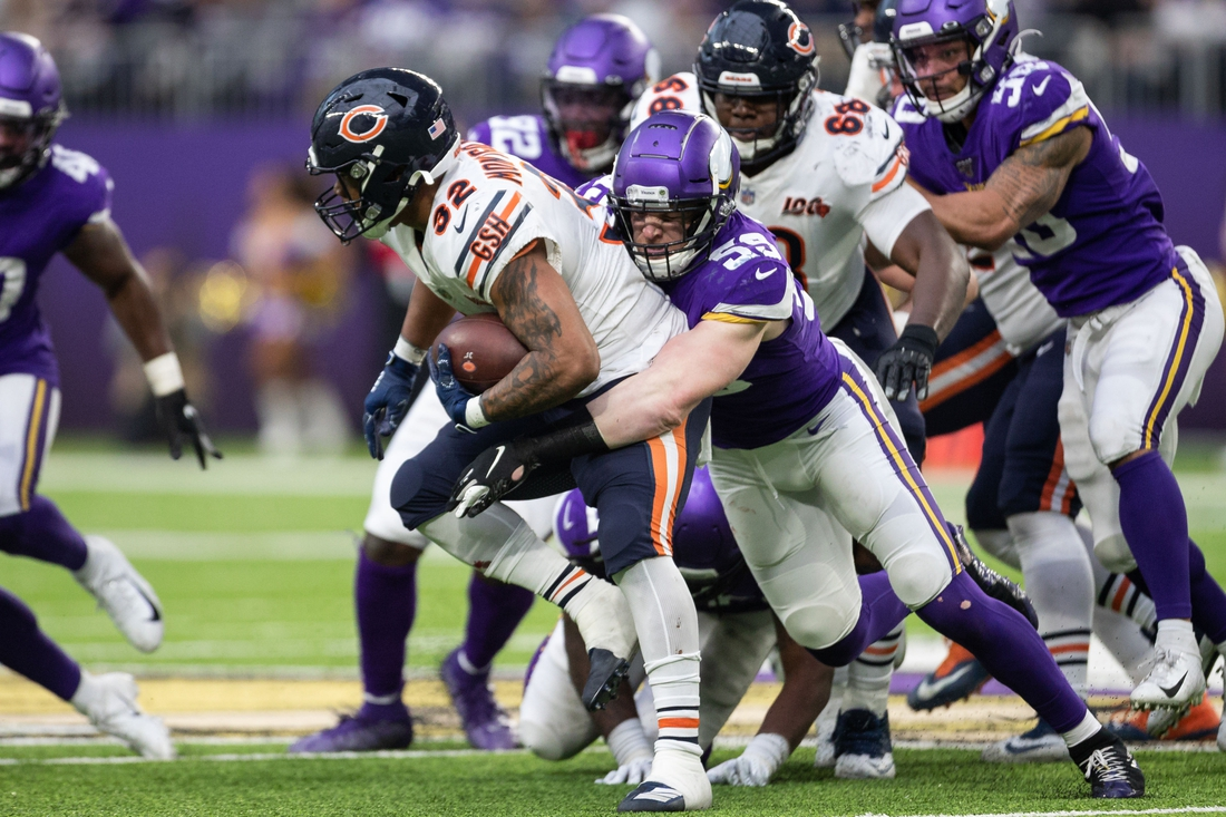 Dec 29, 2019; Minneapolis, Minnesota, USA; Minnesota Vikings inside linebacker Cameron Smith (59) tackles Chicago Bears running back David Montgomery (32) during the third quarter at U.S. Bank Stadium. Mandatory Credit: Harrison Barden-USA TODAY Sports