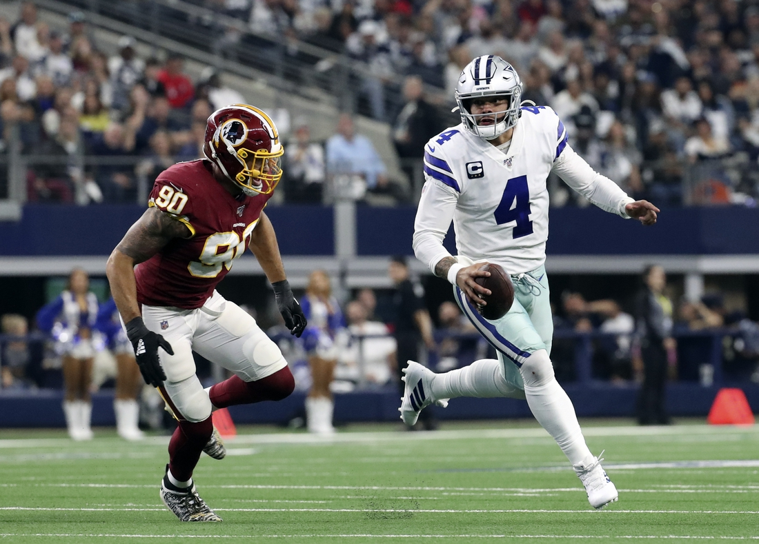Dec 29, 2019; Arlington, Texas, USA;  Dallas Cowboys quarterback Dak Prescott (4) looks to throw past Washington linebacker Montez Sweat (90) during the first quarterat AT&T Stadium. Mandatory Credit: Kevin Jairaj-USA TODAY Sports
