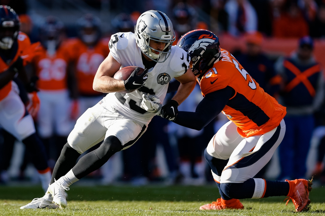 Dec 29, 2019; Denver, Colorado, USA; Oakland Raiders wide receiver Hunter Renfrow (13) is tackled by Denver Broncos inside linebacker Todd Davis (51) in the first quarter at Empower Field at Mile High. Mandatory Credit: Isaiah J. Downing-USA TODAY Sports