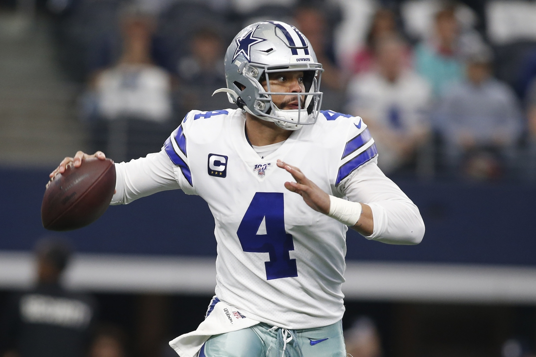 Dec 29, 2019; Arlington, Texas, USA; Dallas Cowboys quarterback Dak Prescott (4) rolls out in the first quarter against the Washington Redskins at AT&T Stadium. Mandatory Credit: Tim Heitman-USA TODAY Sports