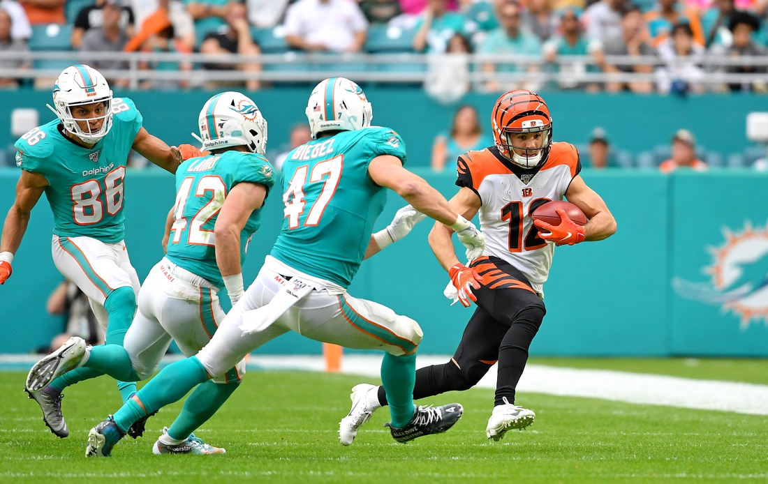 Dec 22, 2019; Miami Gardens, Florida, USA; Cincinnati Bengals wide receiver Alex Erickson (12) is chased by Miami Dolphins linebacker Vince Biegel (47) during the first half at Hard Rock Stadium. Mandatory Credit: Steve Mitchell-USA TODAY Sports
