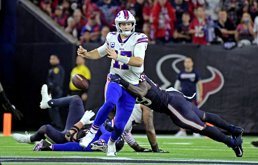 Jan 4, 2020; Houston, Texas, USA; Houston Texans outside linebacker Whitney Mercilus (59) forces Buffalo Bills quarterback Josh Allen (17) to fumble during the fourth quarter in the AFC Wild Card NFL Playoff game at NRG Stadium. Mandatory Credit: Kirby Lee-USA TODAY Sports