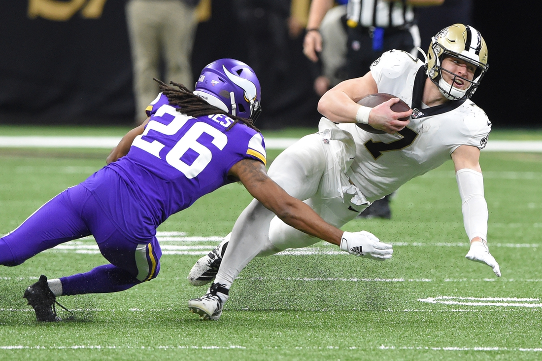Jan 5, 2020; New Orleans, Louisiana, USA; New Orleans Saints quarterback Taysom Hill (7) runs the ball against Minnesota Vikings cornerback Trae Waynes (26) during the fourth quarter of a NFC Wild Card playoff football game at the Mercedes-Benz Superdome. Mandatory Credit: John David Mercer-USA TODAY Sports