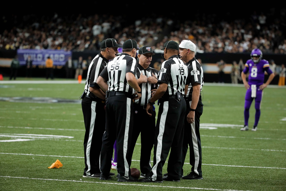 Jan 5, 2020; New Orleans, Louisiana, USA; Officials huddle following a penalty during the third quarter of a NFC Wild Card playoff football game between the New Orleans Saints and the Minnesota Vikings at the Mercedes-Benz Superdome. Mandatory Credit: Derick Hingle-USA TODAY Sports