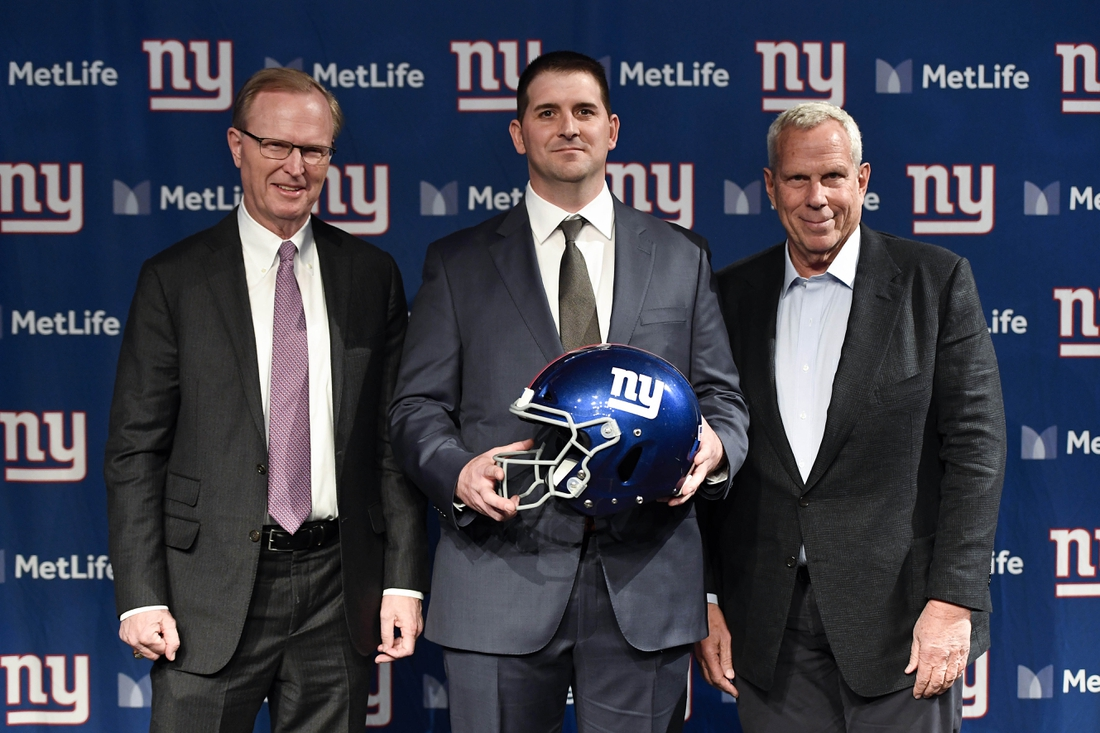 Jan 9, 2020; East Rutherford, New Jersey, USA;  (from left) New York Giants CEO John Mara, new head coach Joe Judge, and co-owner Steve Tisch pose for photos at MetLife Stadium. Mandatory Credit: Danielle Parhizkaran-USA TODAY Sports