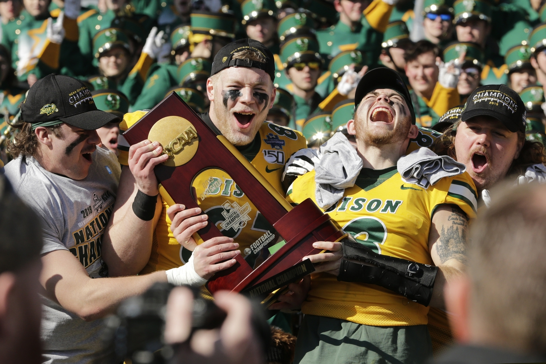 Jan 11, 2020; Frisco, Texas, USA; North Dakota State Bison tight end Noah Gindorff (87) and North Dakota State Bison linebacker Jaxon Brown (3) celebrate with the trophy after the game against the James Madison Dukes at Toyota Stadium. Mandatory Credit: Tim Heitman-USA TODAY Sports