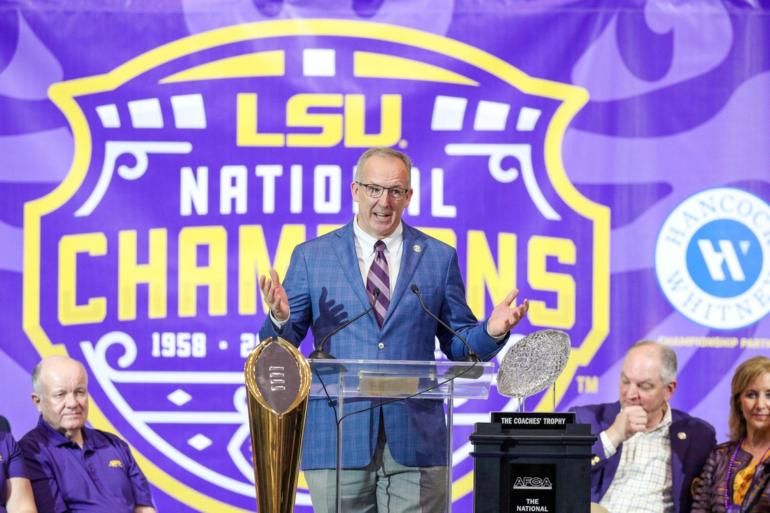 Jan 18, 2020; Baton Rouge, Louisiana, USA; Southeastern Conference Commissioner Greg Sankey presents the SEC trophy to LSU during the LSU championship trophy presentation at Pete Maravich Assembly Center. Mandatory Credit: Stephen Lew-USA TODAY Sports