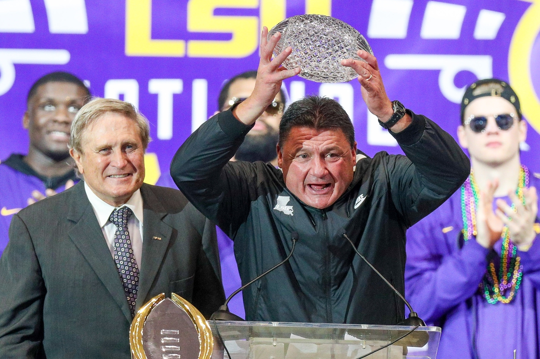 Jan 18, 2020; Baton Rouge, Louisiana, USA;  LSU Tigers head coach Ed Orgeron holds up the AFCA Coaches  Trophy presented by Amway during the LSU championship trophy presentation at Pete Maravich Assembly Center. Mandatory Credit: Stephen Lew-USA TODAY Sports