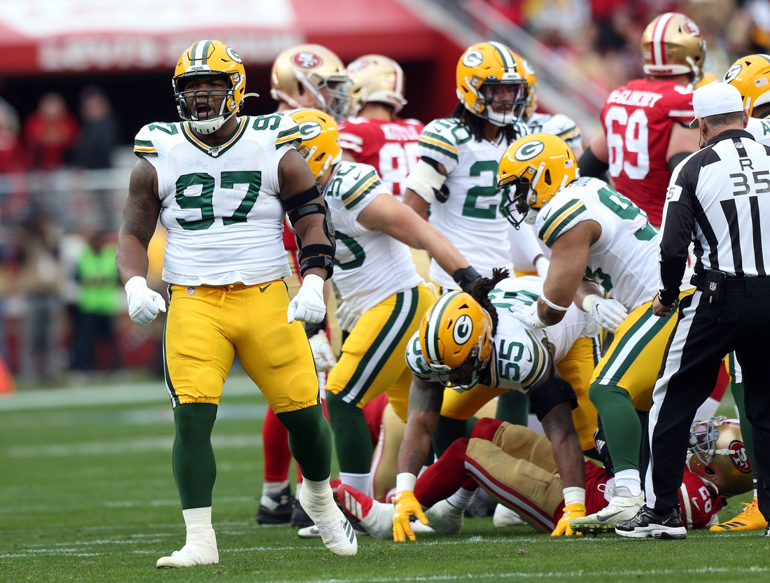 Jan 19, 2020; Santa Clara, California, USA; Green Bay Packers nose tackle Kenny Clark (97) reacts after a defensive play during the first half in the NFC Championship Game at Levi's Stadium. Mandatory Credit: Cary Edmondson-USA TODAY Sports