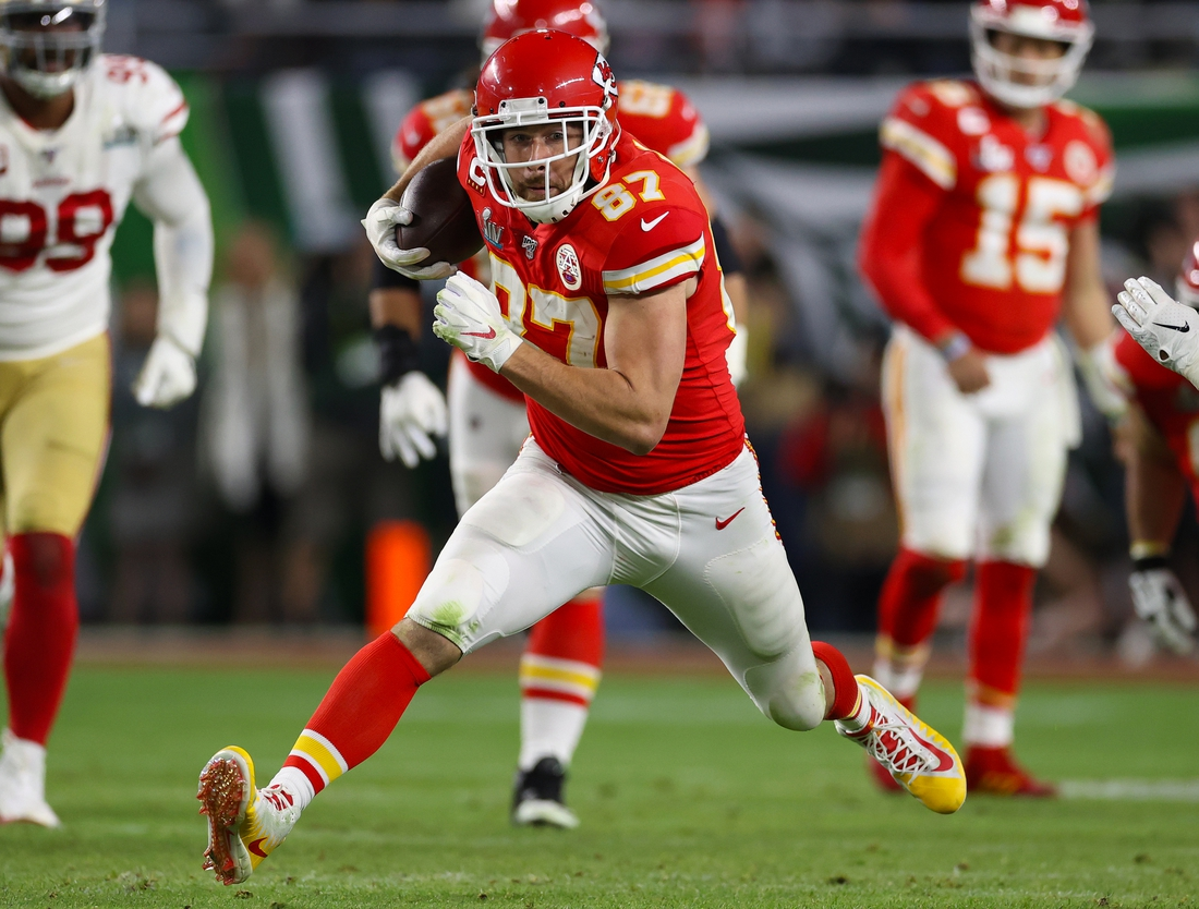 Feb 2, 2020; Miami Gardens, Florida, USA; Kansas City Chiefs tight end Travis Kelce (87) runs after a reception in the third quarter against the San Francisco 49ers in Super Bowl LIV at Hard Rock Stadium. Mandatory Credit: Matthew Emmons-USA TODAY Sports