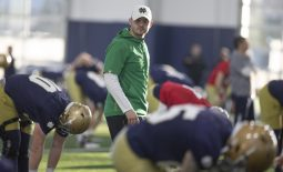 March 5, 2020; South Bend, IN, USA; Notre Dame offensive coordinator Tommy Rees walks amongst the players during Notre Dame's first spring football practice at the Irish Athletics Center. Mandatory Credit: Santiago Flores/South Bend Tribune via USA TODAY NETWORK