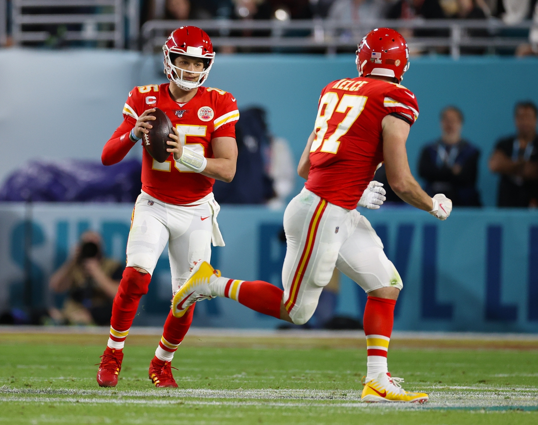 Feb 2, 2020; Miami Gardens, Florida, USA; Kansas City Chiefs quarterback Patrick Mahomes (15) prepares to throw to tight end Travis Kelce (87) against the San Francisco 49ers in Super Bowl LIV at Hard Rock Stadium. Mandatory Credit: Matthew Emmons-USA TODAY Sports