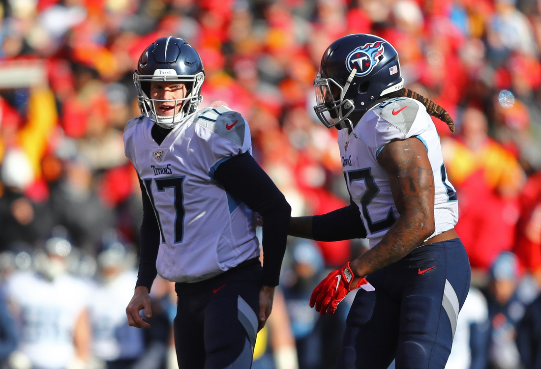 Jan 19, 2020; Kansas City, Missouri, USA; Tennessee Titans quarterback Ryan Tannehill (17) and running back Derrick Henry (22) against the Kansas City Chiefs during the AFC Championship Game at Arrowhead Stadium. Mandatory Credit: Mark J. Rebilas-USA TODAY Sports