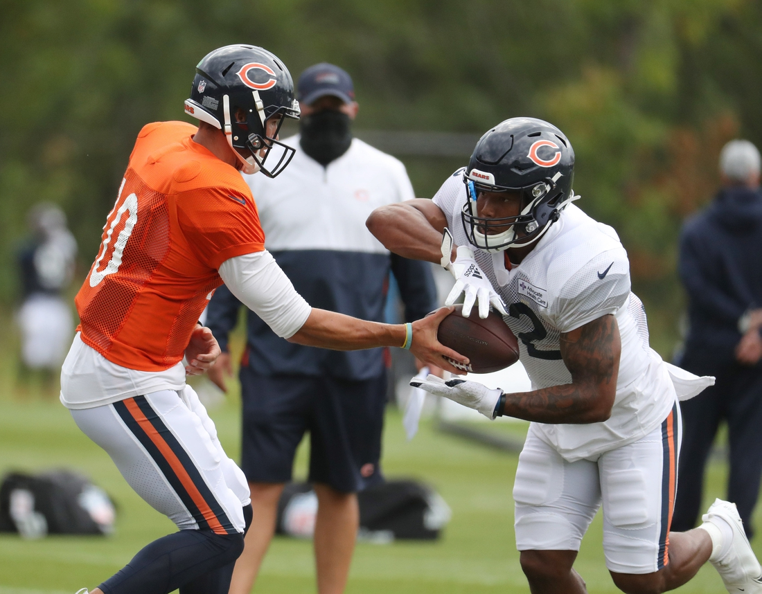 Aug 25, 2020; Lake Forest, IL, USA;  Chicago Bears quarterback Mitch Trubisky (10) hands off to running back David Montgomery (32) during training camp Tuesday, Aug. 25, 2020 at Halas Hall. Mandatory Credit: Brian Cassella/Pool Photo-USA TODAY Sports