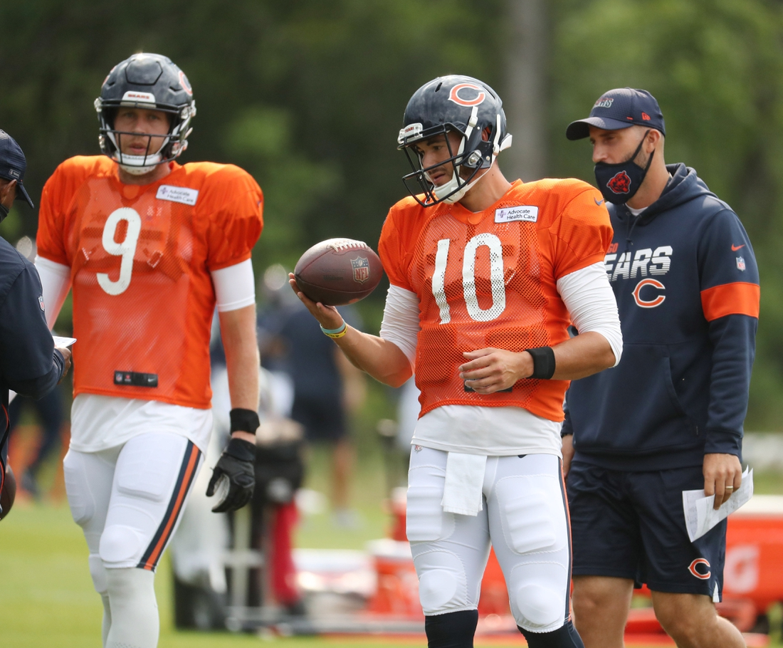 Aug 25, 2020; Lake Forest, IL, USA;   Chicago Bears quarterbacks Nick Foles (9) and Mitch Trubisky (10) and coach Dave Ragone during training camp Tuesday, Aug. 25, 2020 at Halas Hall. Mandatory Credit: Brian Cassella/Pool Photo-USA TODAY Sports