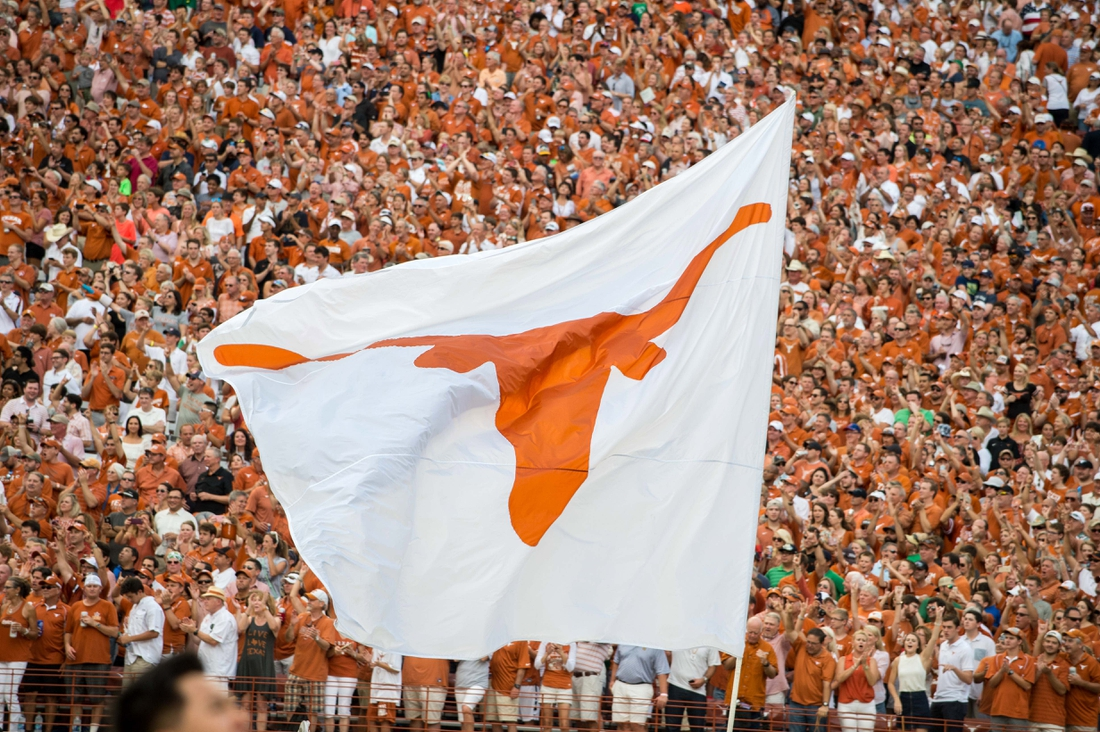 Sep 4, 2016; Austin, TX, USA; The Texas Longhorns logo flag flies during the game between the Texas Longhorns and the Notre Dame Fighting Irish at Darrell K. Royal-Texas Memorial Stadium. Texas won 50-47 in double overtime. Mandatory Credit: Matt Cashore-USA TODAY Sports
