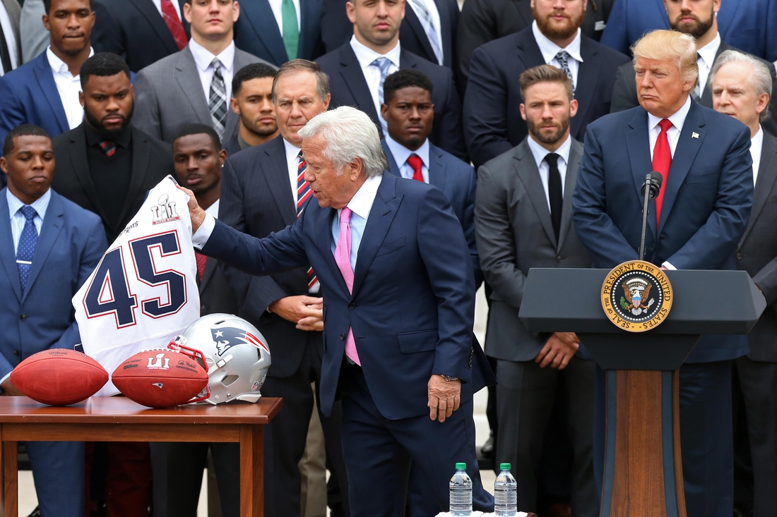 Apr 19, 2017; Washington, DC, USA; New England Patriots owner Robert Kraft (L) presents President Donald Trump (R) with a team jersey at a ceremony honoring the Super Bowl LI champion New England Patriots on the South Lawn at the White House. Mandatory Credit: Geoff Burke-USA TODAY Sports