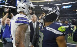 Dec 24, 2017; Arlington, TX, USA; Dallas Cowboys quarterback Dak Prescott (4) meets with Seattle Seahawks quarterback Russell Wilson (3) after a game at AT&T Stadium. Mandatory Credit: Tim Heitman-USA TODAY Sports