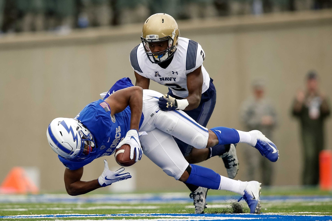 Oct 6, 2018; Colorado Springs, CO, USA; Air Force Falcons wide receiver Geraud Sanders (7) makes a catch ahead of Navy Midshipmen cornerback Jarid Ryan (2) in the third quarter at Falcon Stadium. Mandatory Credit: Isaiah J. Downing-USA TODAY Sports