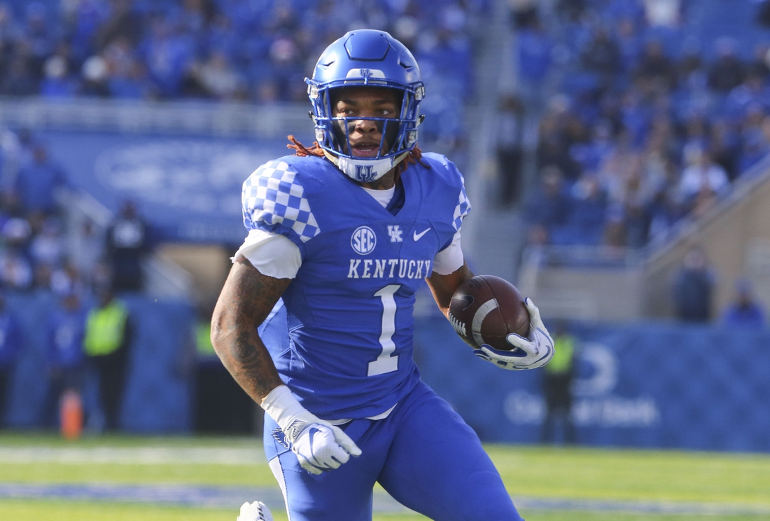 Nov 17, 2018; Lexington, KY, USA; Kentucky Wildcats wide receiver Lynn Bowden Jr. (1) runs the ball against the Middle Tennessee Blue Raiders in the second half at Kroger Field. Kentucky defeated Middle Tennessee 34-23. Mandatory Credit: Mark Zerof-USA TODAY Sports