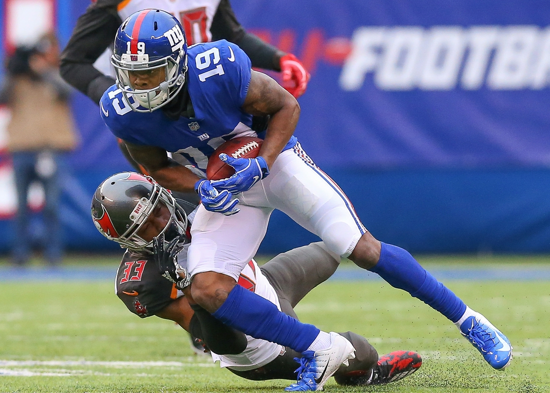 Nov 18, 2018; East Rutherford, NJ, USA; New York Giants wide receiver Corey Coleman (19) is tackled by Tampa Bay Buccaneers cornerback Carlton Davis (33) during the first half at MetLife Stadium. Mandatory Credit: Vincent Carchietta-USA TODAY Sports