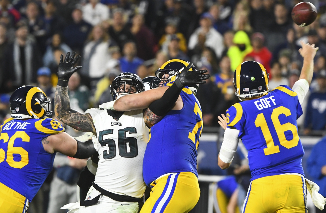 Dec 16, 2018; Los Angeles, CA, USA; Philadelphia Eagles defensive end Chris Long (56) is stopped from reaching Rams quarterback Jared Goff (16) by offensive guard Austin Blythe (66) and Rams offensive tackle Rob Havenstein (79) during the third quarter at Los Angeles Memorial Coliseum. Mandatory Credit: Robert Hanashiro-USA TODAY Sports