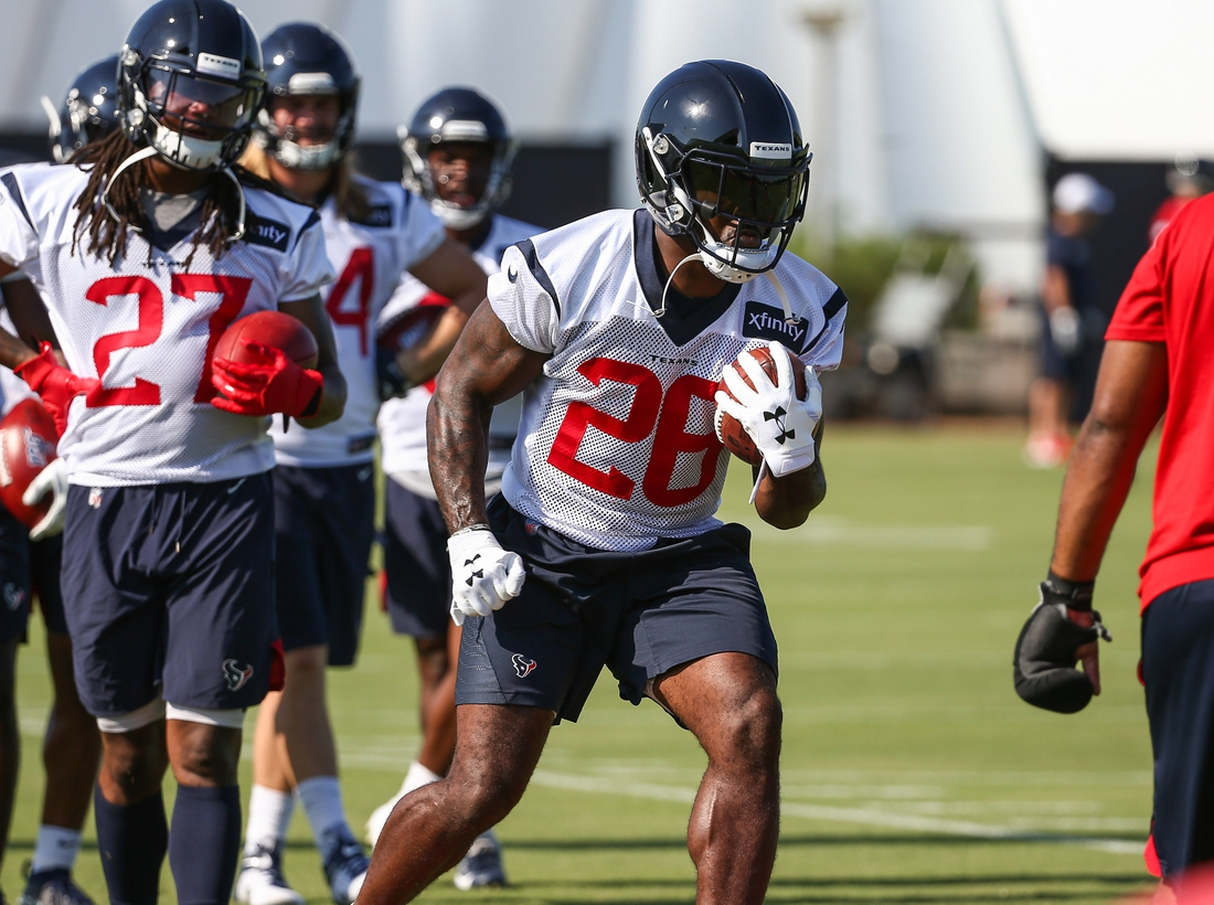 Jul 25, 2019; Houston, TX, USA; Houston Texans running back Lamar Miller (26) during training camp at Houston Methodist Training Center. Mandatory Credit: Troy Taormina-USA TODAY Sports
