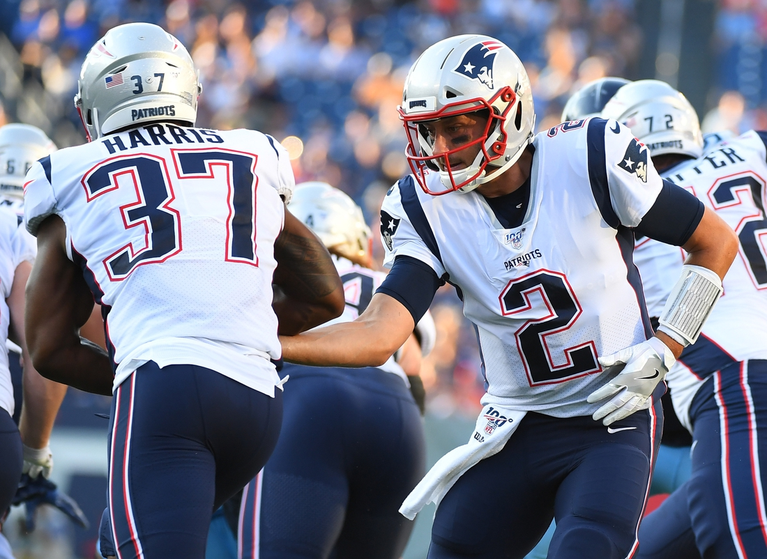 Aug 17, 2019; Nashville, TN, USA; New England Patriots quarterback Brian Hoyer (2) hands the ball off to New England Patriots running back Damien Harris (37) during the first half of the preseason game against the Tennessee Titans at Nissan Stadium. Mandatory Credit: Christopher Hanewinckel-USA TODAY Sports