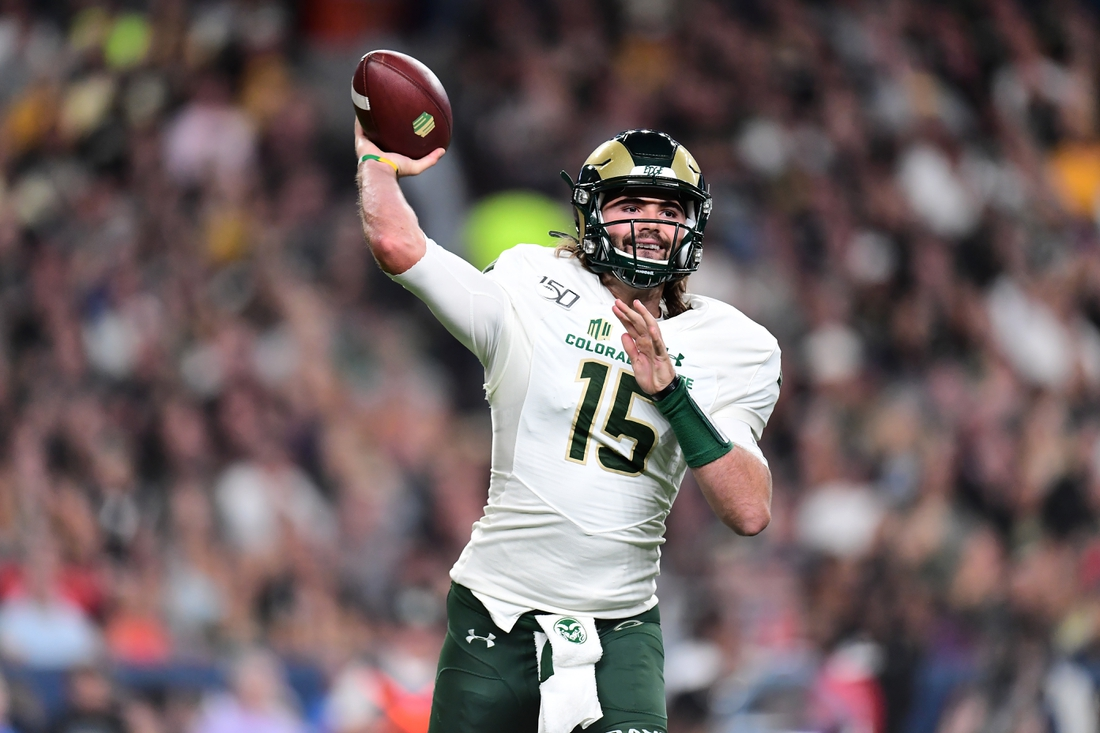 Aug 30, 2019; Denver, CO, USA; Colorado State Rams quarterback Collin Hill (15) passes the ball in the first quarter against the Colorado Buffaloes at Broncos Stadium at Mile High. Mandatory Credit: Ron Chenoy-USA TODAY Sports