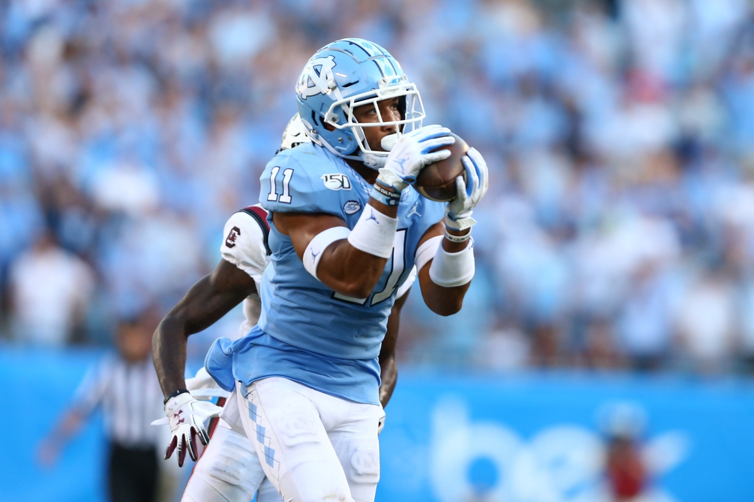 Aug 31, 2019; Charlotte, NC, USA; North Carolina Tar Heels defensive back Myles Wolfolk (11) intercepts a pass during the fourth quarter against the South Carolina Gamecocks at Bank of America Stadium. Mandatory Credit: Jeremy Brevard-USA TODAY Sports