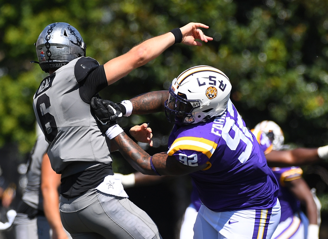 Sep 21, 2019; Nashville, TN, USA; Vanderbilt Commodores quarterback Riley Neal (6) is hit by LSU Tigers defensive end Neil Farrell Jr. (92) after throwing the ball during the first half at Vanderbilt Stadium. Mandatory Credit: Christopher Hanewinckel-USA TODAY Sports