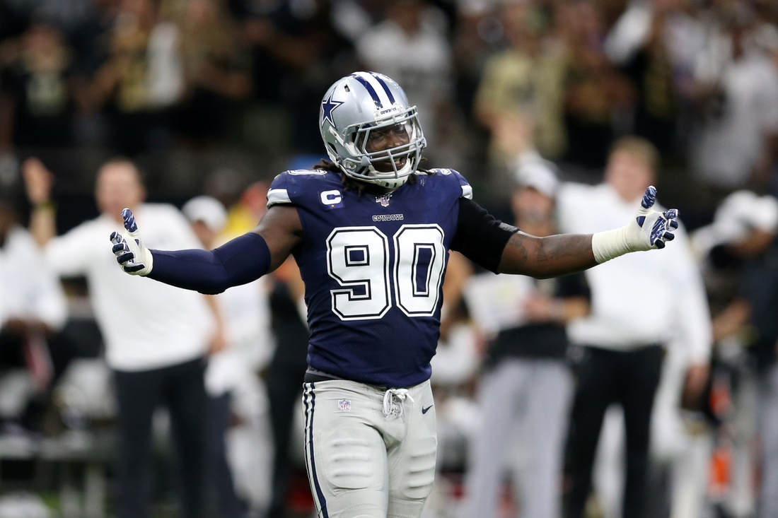 Sep 29, 2019; New Orleans, LA, USA; Dallas Cowboys defensive end Demarcus Lawrence (90) gestures after being called for a penalty in the second quarter against the New Orleans Saints at the Mercedes-Benz Superdome. Mandatory Credit: Chuck Cook-USA TODAY Sports