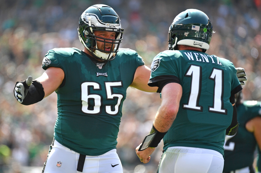 Sep 22, 2019; Philadelphia, PA, USA; Philadelphia Eagles offensive tackle Lane Johnson (65) celebrates with  quarterback Carson Wentz (11) against the Detroit Lions at Lincoln Financial Field. Mandatory Credit: Eric Hartline-USA TODAY Sports
