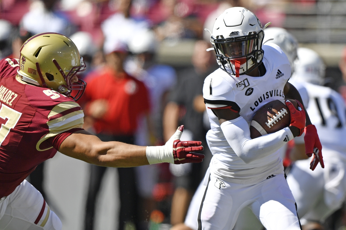 Oct 5, 2019; Louisville, KY, USA; Louisville Cardinals wide receiver Tutu Atwell (1) avoids the tackle of Boston College Eagles defensive end Marcus Valdez (97) during the second quarter of play at Cardinal Stadium. Mandatory Credit: Jamie Rhodes-USA TODAY Sports