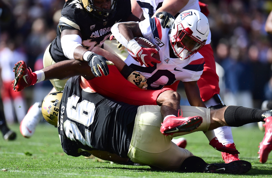 Oct 5, 2019; Boulder, CO, USA; Colorado Buffaloes linebacker Carson Wells (26) tackles Arizona Wildcats running back Darrius Smith (20) in the first quarter at Folsom Field. Mandatory Credit: Ron Chenoy-USA TODAY Sports