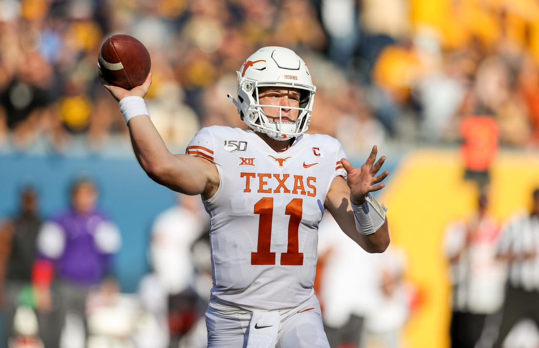 Oct 5, 2019; Morgantown, WV, USA; Texas Longhorns quarterback Sam Ehlinger (11) throws a pass during the first quarter against the West Virginia Mountaineers at Mountaineer Field at Milan Puskar Stadium. Mandatory Credit: Ben Queen-USA TODAY Sports