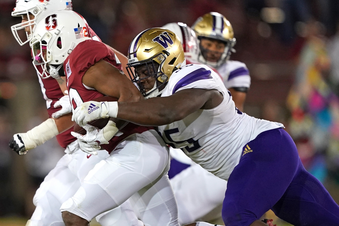 Oct 5, 2019; Stanford, CA, USA; Washington Huskies defensive lineman Levi Onwuzurike (95) tackles Stanford Cardinal running back Dorian Maddox (28) during the third quarter at Stanford Stadium. Mandatory Credit: Darren Yamashita-USA TODAY Sports
