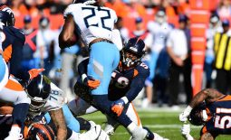 Oct 13, 2019; Denver, CO, USA; Denver Broncos linebacker Von Miller (58) tackles Tennessee Titans running back Derrick Henry (22) in the second quarter at Empower Field at Mile High. Mandatory Credit: Ron Chenoy-USA TODAY Sports