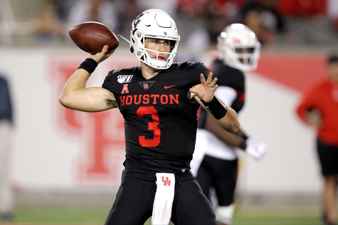 Oct 24, 2019; Houston, TX, USA; Houston Cougars quarterback Clayton Tune (3) reaches back to pass downfield against the Southern Methodist Mustangs during the third quarter at TDECU Stadium. Mandatory Credit: Erik Williams-USA TODAY Sports