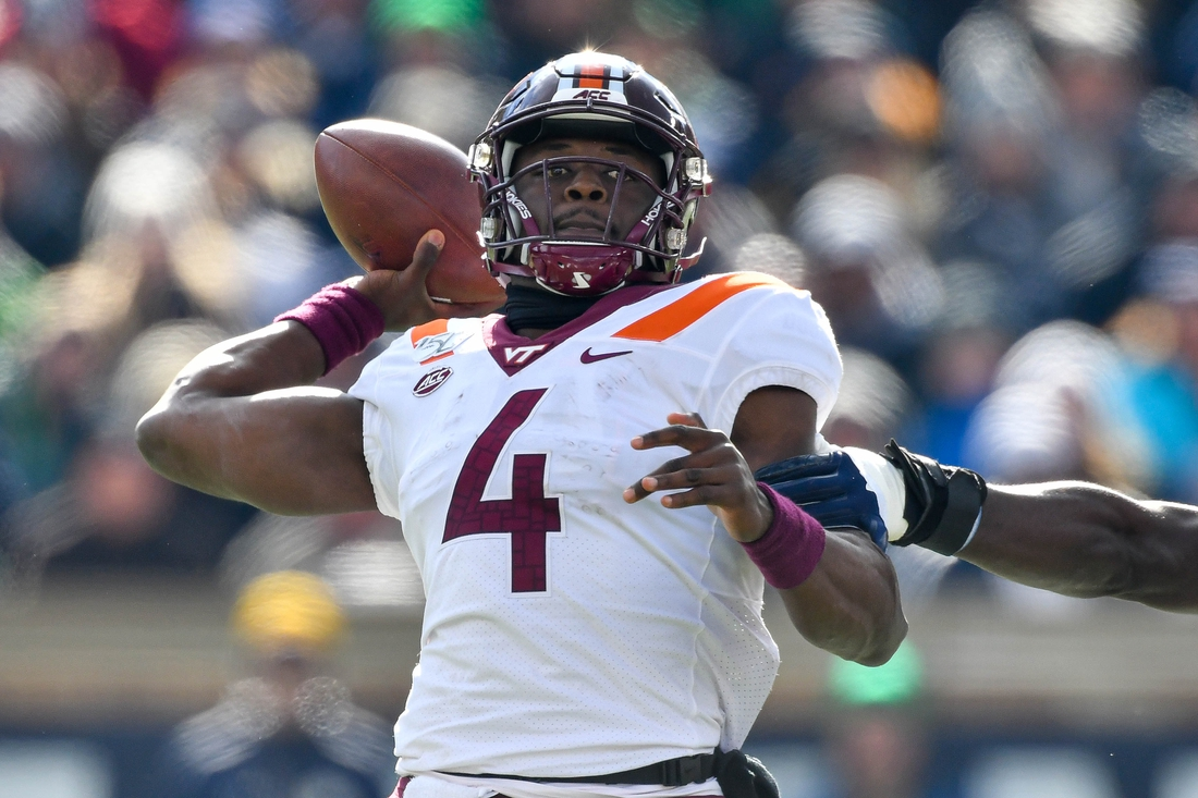 Nov 2, 2019; South Bend, IN, USA; Virginia Tech Hokies quarterback Quincy Patterson (4) throws in the first quarter against the Notre Dame Fighting Irish at Notre Dame Stadium. Mandatory Credit: Matt Cashore-USA TODAY Sports
