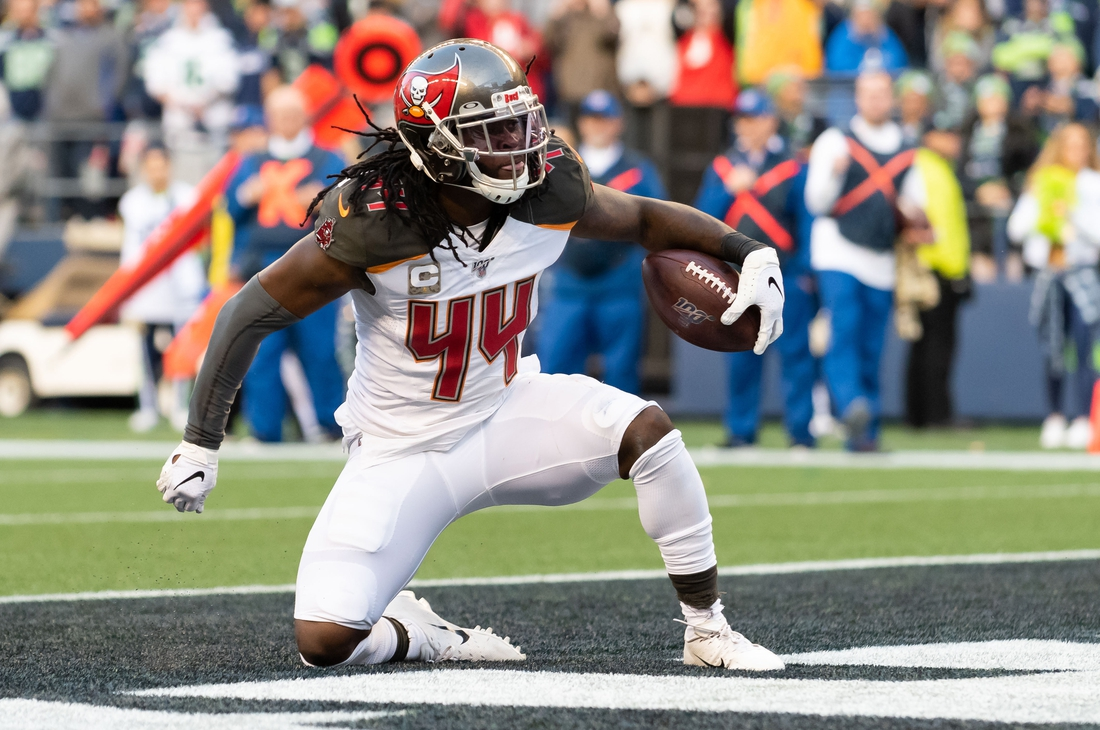 Nov 3, 2019; Seattle, WA, USA; Tampa Bay Buccaneers running back Dare Ogunbowale (44) celebrates after scoring a touchdown against the Seattle Seahawks during the second half at CenturyLink Field. Seattle defeated Tampa Bay 40-34. Mandatory Credit: Steven Bisig-USA TODAY Sports