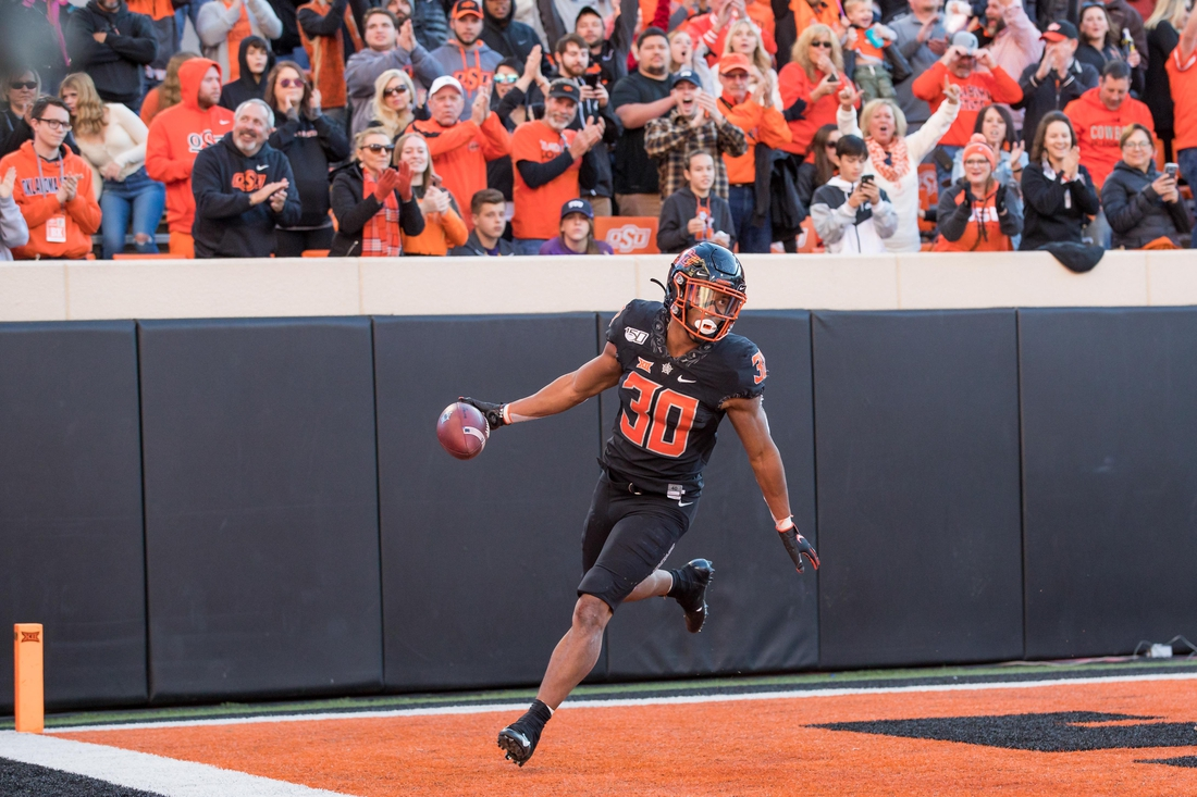 Nov 2, 2019; Stillwater, OK, USA; Oklahoma State Cowboys running back Chuba Hubbard (30) turns to celebrate after scoring a touchdown against the TCU Horned Frogs during the fourth quarter at Boone Pickens Stadium. Oklahoma State defeated TCU 34-27. Mandatory Credit: Brett Rojo-USA TODAY Sports