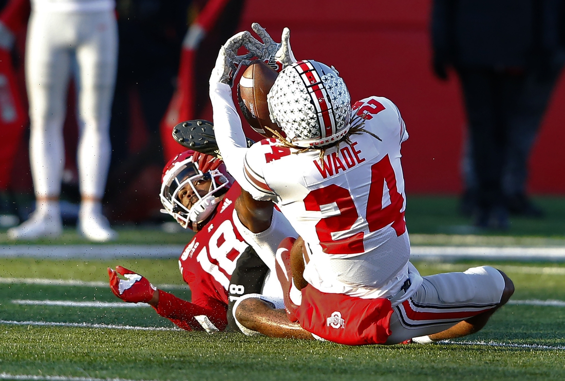 Nov 16, 2019; Piscataway, NJ, USA; Ohio State Buckeyes cornerback Shaun Wade (24) intercepts a pass against Rutgers Scarlet Knights wide receiver Bo Melton (18) during the first half at SHI Stadium. Mandatory Credit: Noah K. Murray-USA TODAY Sports