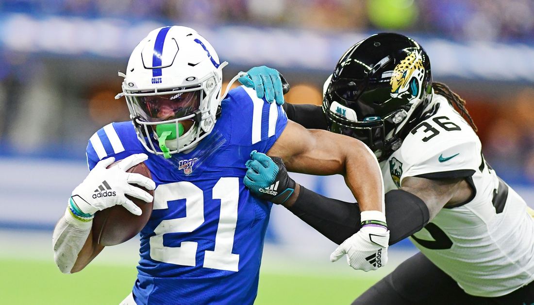 Nov 17, 2019; Indianapolis, IN, USA; Indianapolis Colts running back Nyheim Hines  (21) carries the ball as Jacksonville Jaguars safety Ronnie Harrison (36) tackles in the first half at Lucas Oil Stadium. Mandatory Credit: Thomas J. Russo-USA TODAY Sports