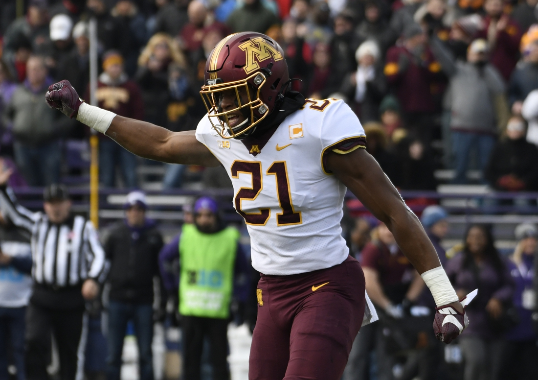 Nov 23, 2019; Evanston, IL, USA; Minnesota Golden Gophers linebacker Kamal Martin (21) gestures after sacking the Northwestern Wildcats quarterback during the first half at Ryan Field. Mandatory Credit: David Banks-USA TODAY Sports