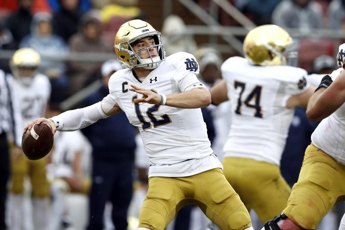 Nov 30, 2019; Stanford, CA, USA; Notre Dame Fighting Irish quarterback Ian Book (12) throws a pass during the second quarter against the Stanford Cardinal at Stanford Stadium. Mandatory Credit: Darren Yamashita-USA TODAY Sports