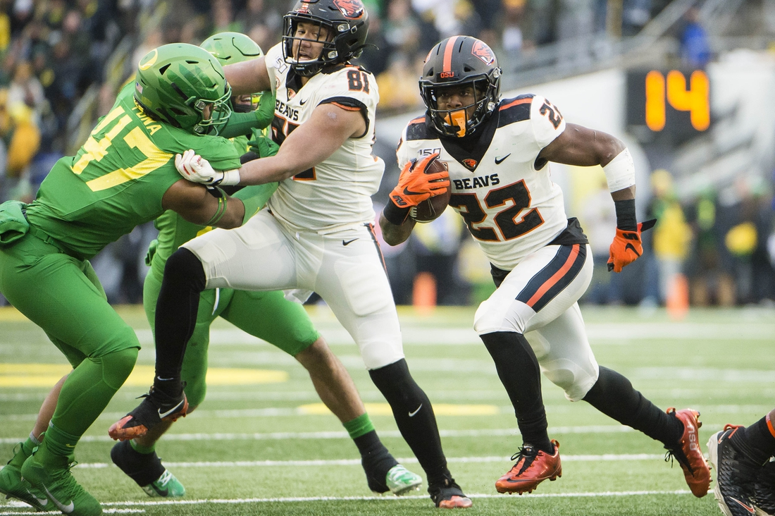 Nov 30, 2019; Eugene, OR, USA; Oregon State Beavers running back Jermar Jefferson (22) scores a touchdown on a running play during the second half against the Oregon Ducks at Autzen Stadium. The Oregon Ducks beat the Oregon State Beavers 24-10. Mandatory Credit: Troy Wayrynen-USA TODAY Sports